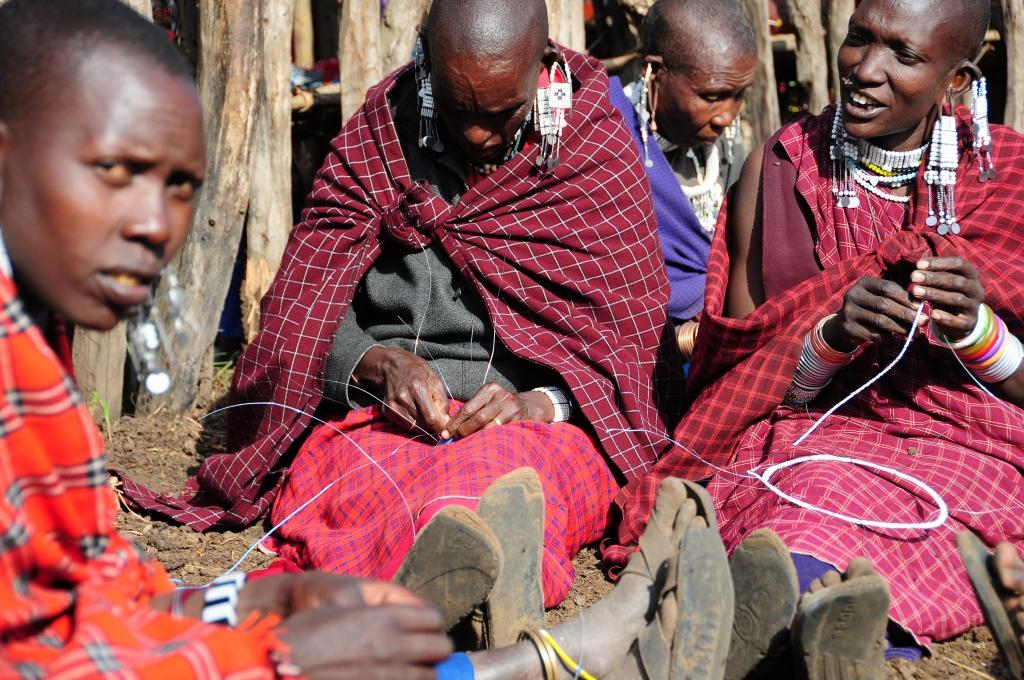maasai women making maasai jewelry